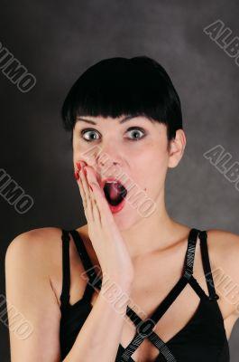 surprised woman over dark background