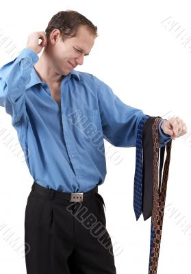 Businessman choosing a tie