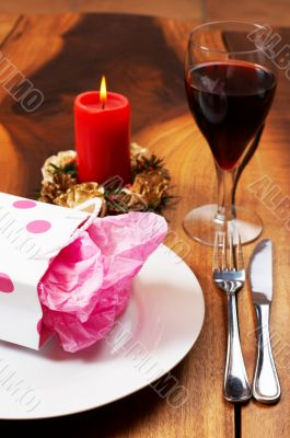 Table setting with a gift bag on plate