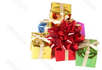 Stack of gift boxes and bow on white