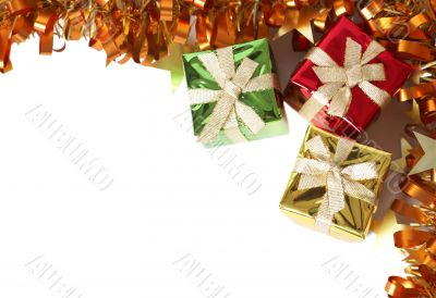 Colorful gift boxes and tinsel forming a frame