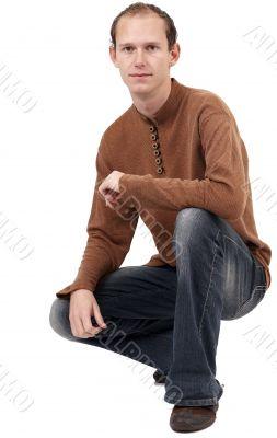 Young caucasian man sitting down
