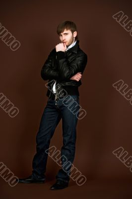 man in leather jacket with crossed hands