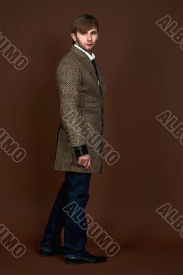 man in striped modern coat