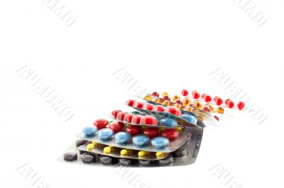 a number of multicolor pill blisters