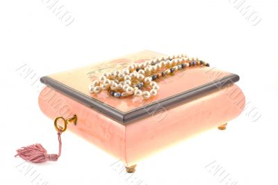 pearl necklaces on encrusted box