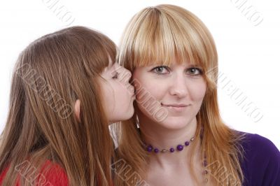 Daughter kissing her happy mother. I love my mom.