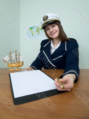 Woman in a sea uniform at table with tablet
