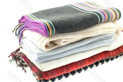 selection of six wool different scarves