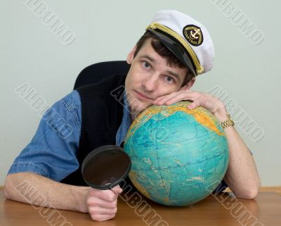 Man in uniform cap with globe