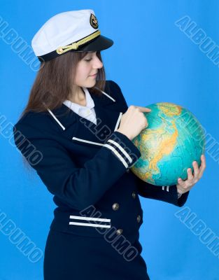 Woman in sea uniform and globe