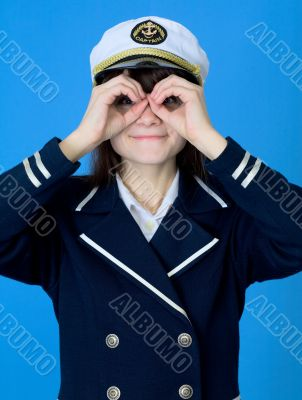 Girl in a sea uniform emits binoculars