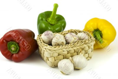 Bell peppers and basket with garlics