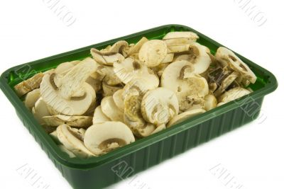 Sliced champignon mushrooms in green pack