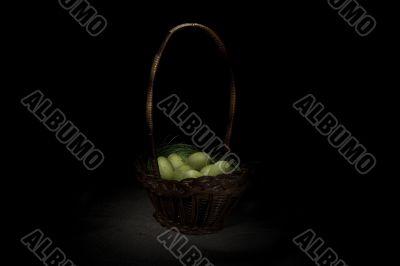 Easter basket on canvas background
