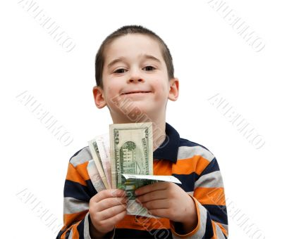 Cute little boy holds banknotes