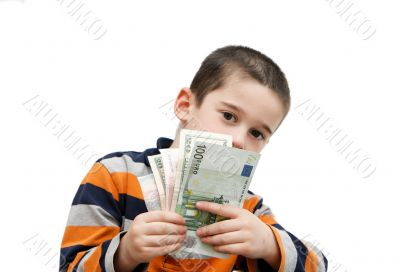 Cute little boy hides behind banknotes