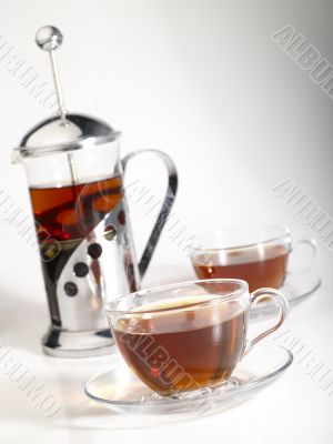 french-press withpair cups of tea and trickle steam