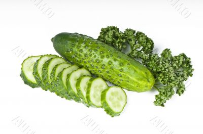 Cutted cucumbers and parsley, healthy food isolated on white