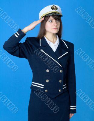 Girl in a sea uniform salutes