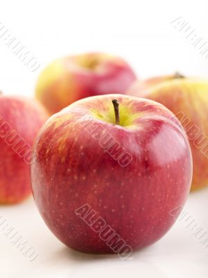 a few apples with shadow on bright background. selective focus