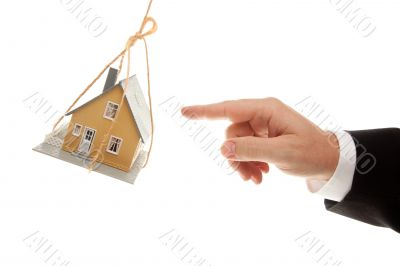 Swinging House and Business Man`s Hand Reaching