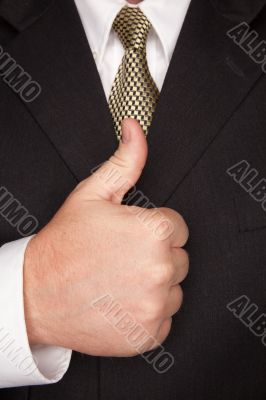 Businessman Gesturing Thumbs Up with Hand