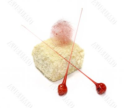 Sweet biscuit cake with two lollipop