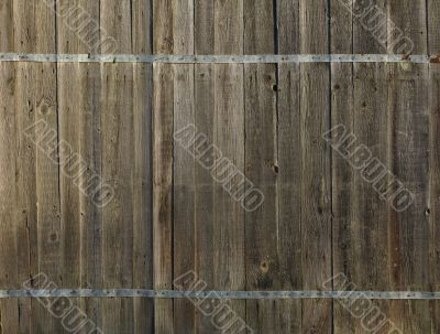 Old wooden fence with metal flat bar