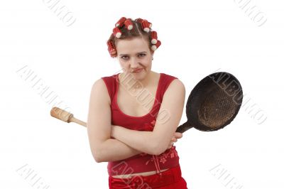 Angry woman with curlers in her hair.