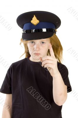 young girl with police hat is giving a warning sign