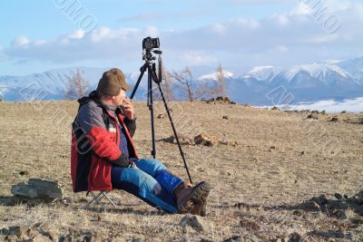 adventure photographer in the mountains
