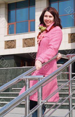 happy smiling young women in pink coat