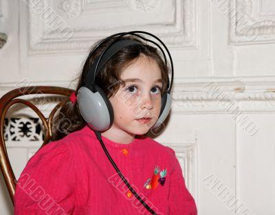 Cute little girl in earphones