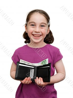Smiling little girl holds wallet with money