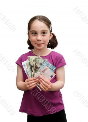 Smiling little girl holds a fan of banknotes