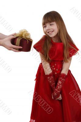 Little girl is getting gift. Girl feels shy.