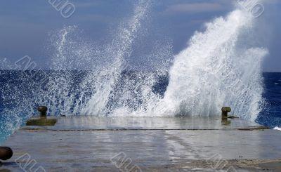 Wave breaking against stone mooring