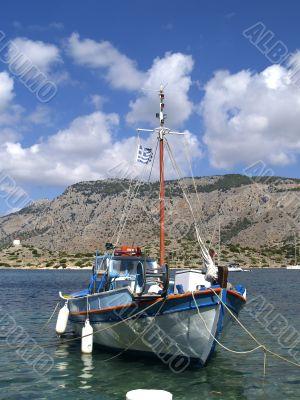 Boat in harbour of island Symi