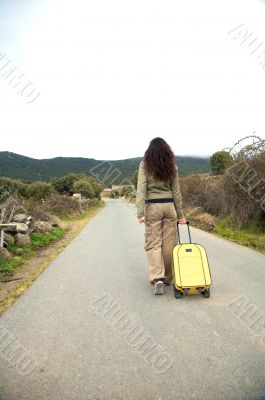 woman walking with suitcase