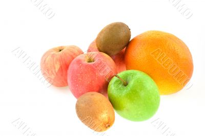 different fruits: apples, grapefruit, kiwi-fruits on a white bac