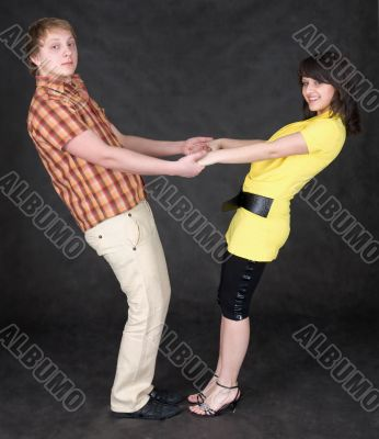 Couple is turned keeping for hands