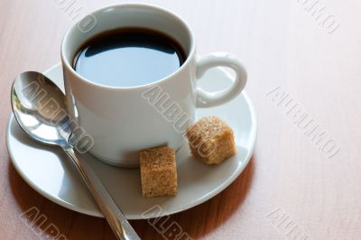 Cup of coffee and reed sugar