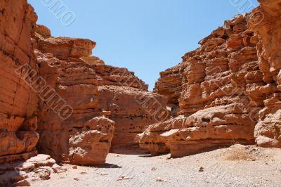 Desert landscape of weathered red rocks