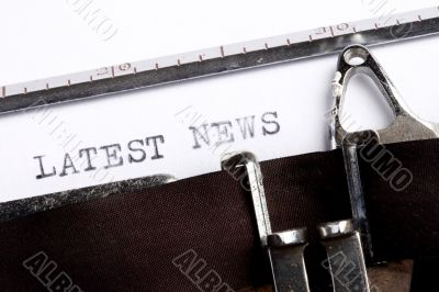 latest news written on old typewriter