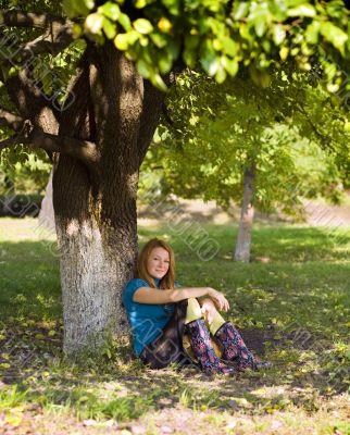 pretty woman under tree
