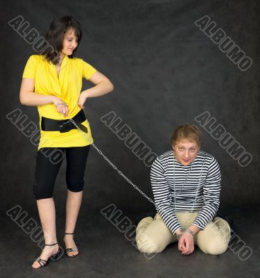 Guy chained in a chain and girl