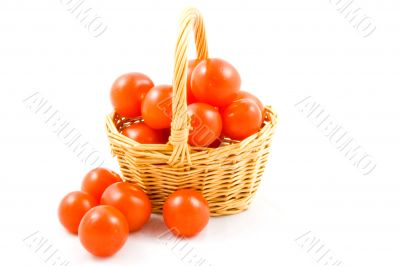 basket full of fresh healthy baby tomatoes on white