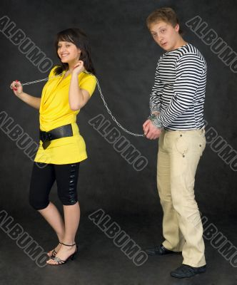 Lady guide shackled young man