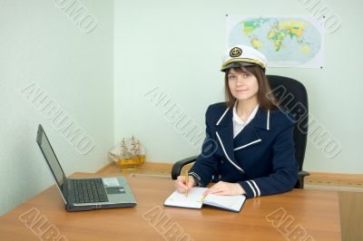 Girl - sea captain at office with laptop